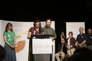 Michele Rowe and Shawn Sanford-Beck, members of KAIROS Saskatoon, offer the Expression of Reconciliation to the gathering of the TRC in Saskatoon.