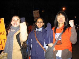Young women at a vigil and march against poverty in Vancouver.