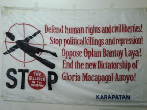 Banner denouncing political killings.