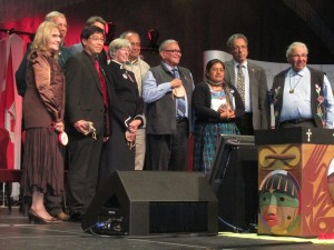 Naty Atz Sunuc is inducted with the other Honourary Witnesses and the TRC Commissioners. The sacred bentwood box is in the foreground.