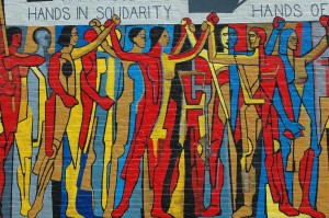 Solidarity Mural from the United Electrical Workers building in Chicago.  Photo: Terence Faircloth, 2006,  Creative Commons License. https://flic.kr/p/evbxT