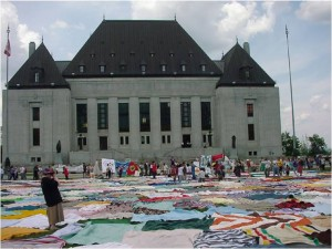 In 2001 KAIROS churches  and networks laid blankets in front of the Supreme Court in Ottawa in support of Aboriginal title and rights.