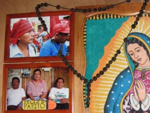 A photo in memory of Adolfo Ich, with the caption 'Happy Father's Day', hangs on the wall of his family home in El Estor.