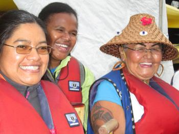 Naty Atz, honorary witness at the TRC National event in BC, joins a boat with members of the local KAIROS group during the opening ceremony, September 2013.