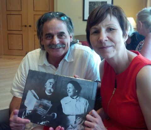 Program Manager Ed Bianchi and KAIROS partner, Dr. Cindy Blackstock, hold a photograph of Peter Henderson Bryce and his wife at a gathering held to unveil a plaque in his honor. Photo by Valerie Galley
