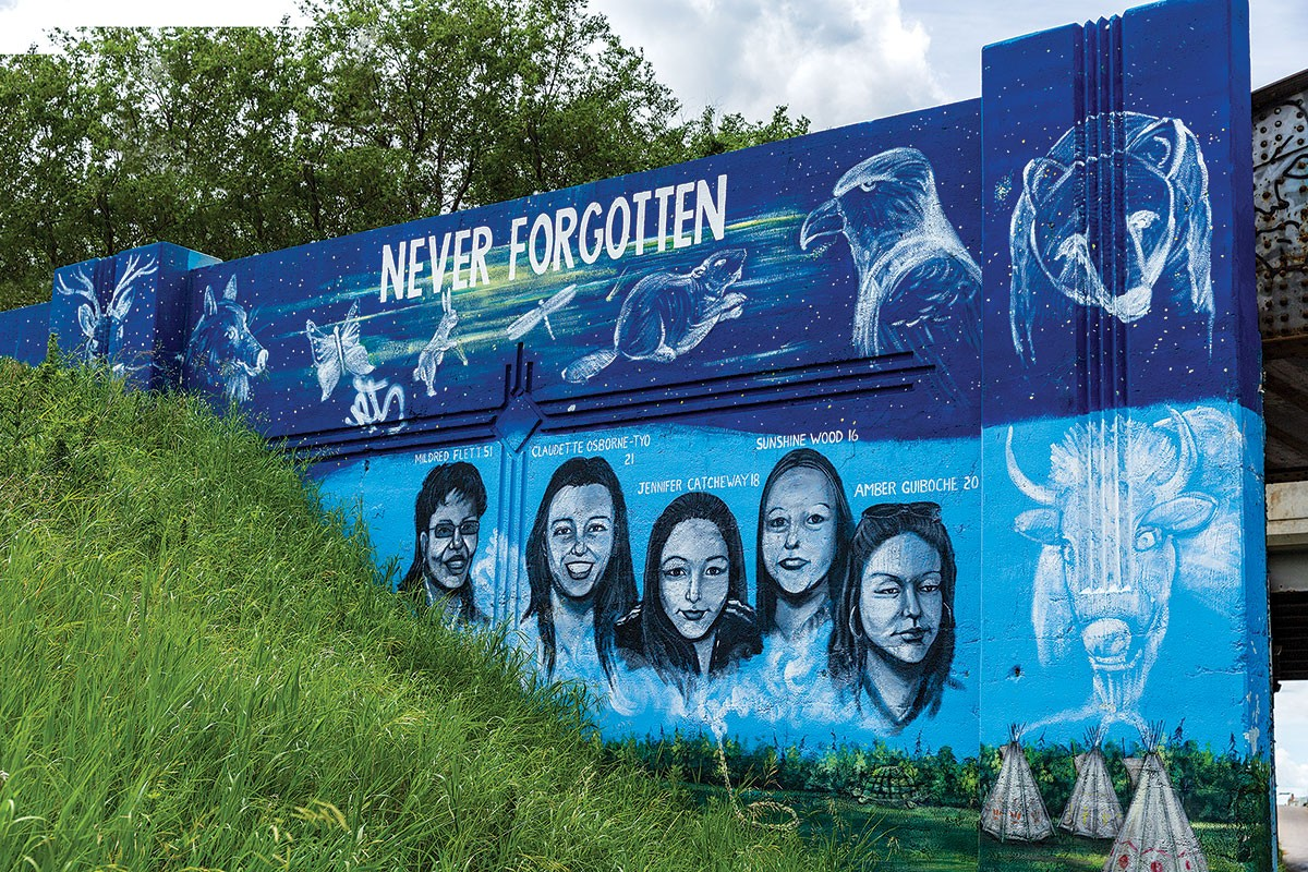 MURAL ARTIST TOM ANDRICH'S PUBLIC ART IN HONOUR OF MMIW, LOCATED ON THE PORTAGE AVE. AND EMPRESS ST. OVERPASS IN WINNIPEG. // PHOTO BY UM TODAY