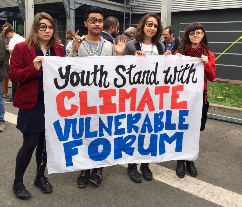 Youth activists supporting climate-vulnerable regions at COP21.