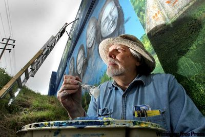 Tom Andrich painting mural, Winnipeg overpass