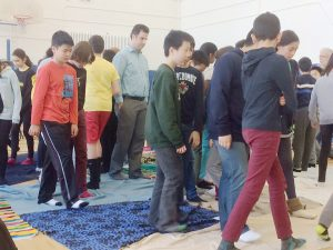Pictured: Students and teachers in the UTS gym during the Blanket Exercise.