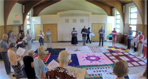 Participants partake in the Blanket Exercise, a workshop that delves into the effects of colonization. Photo by KAIROS Canada