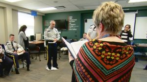 RCMP members from Alberta take part in the Kairos Blanket Exercise in Cochrane. (Laurent Pirot/CBC)