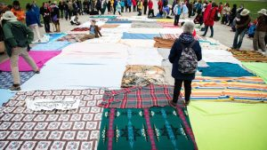 In the blanket exercise, blankets represent land belonging to Indigenous people prior to contact. As the game goes on, the blankets become smaller, with large distances between them.