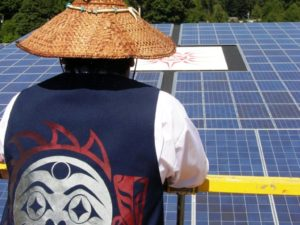 Chief viewing the solar installation. Photo by Shannon Halliday.