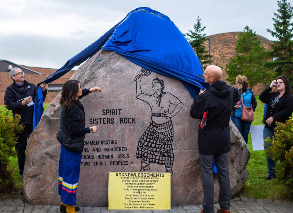Miranda Laroche (left) assists other speakers at the ceremony reveal of the monument. The ceremony, which also saw the monument blessed, was in line with the national day of remembrance for MMIWG. Photo: John Watson / Daily Herald-Tribune