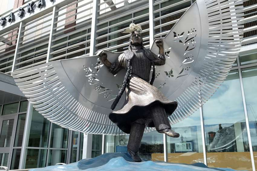 A life-sized bronze monument honouring missing and murdered indigenous women and girls near the main entrance of Saskatoon police headquarters. Created by artist Lionel Peyachew, the sculpture depicts Red Star Woman, a fancy dancer with her shawl as wings