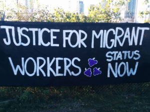 migrant justice banner