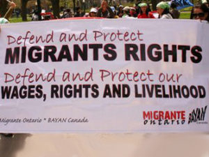Defend and protect migrant rights banner