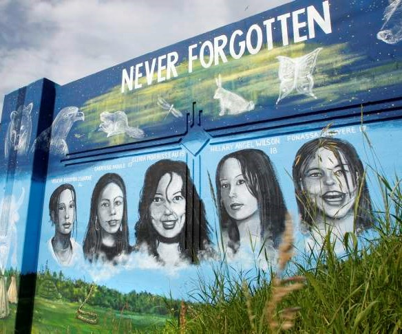 MURAL ARTIST TOM ANDRICH'S PUBLIC ART IN HONOUR OF MMIW, LOCATED ON THE PORTAGE AVE. AND EMPRESS ST. OVERPASS IN WINNIPEG.