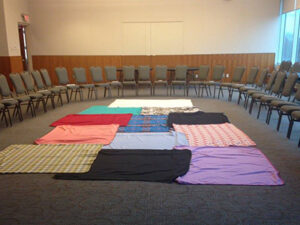 KAIROS blanket exercise circle with empty chairs