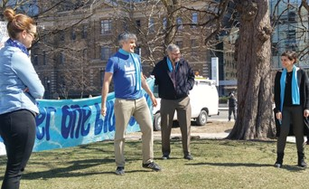 Luke Stocking leading a dramatization at an Earth Day event 'under one blue sky'.