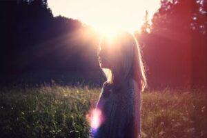 Sun shine behind woman