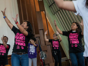 Women dance inside a Protestant church in the Philippines to dramatize calls to end discrimination against women. (Photo by Mark Saludes)