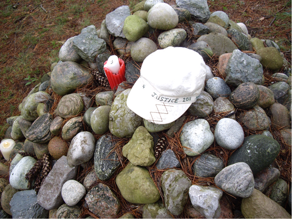 On September 4, 2011, Mabel Todd placed her Walk4Justice cap on the cairn at Maryholme, Keswick, close to the shore of Lake Simcoe.